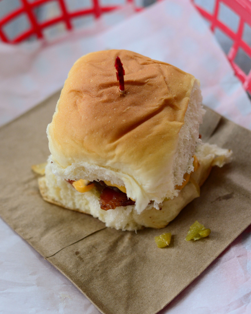 new tailgating recipe: It's a sweet Hawaiian roll, with a mini hamburger patty, roasted Hatch Green Chilies, sweet sautéed onions, crisp bacon, and cheese. www.thenewmrsallen.com
