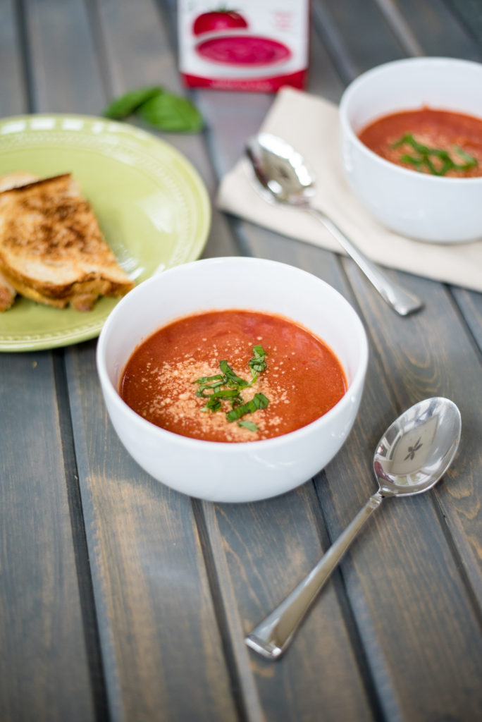 My creamy tomato basil soup is smooth, velvety, + topped with fresh basil and parmesan cheese. The addition of orzo to add just the right amount of texture.