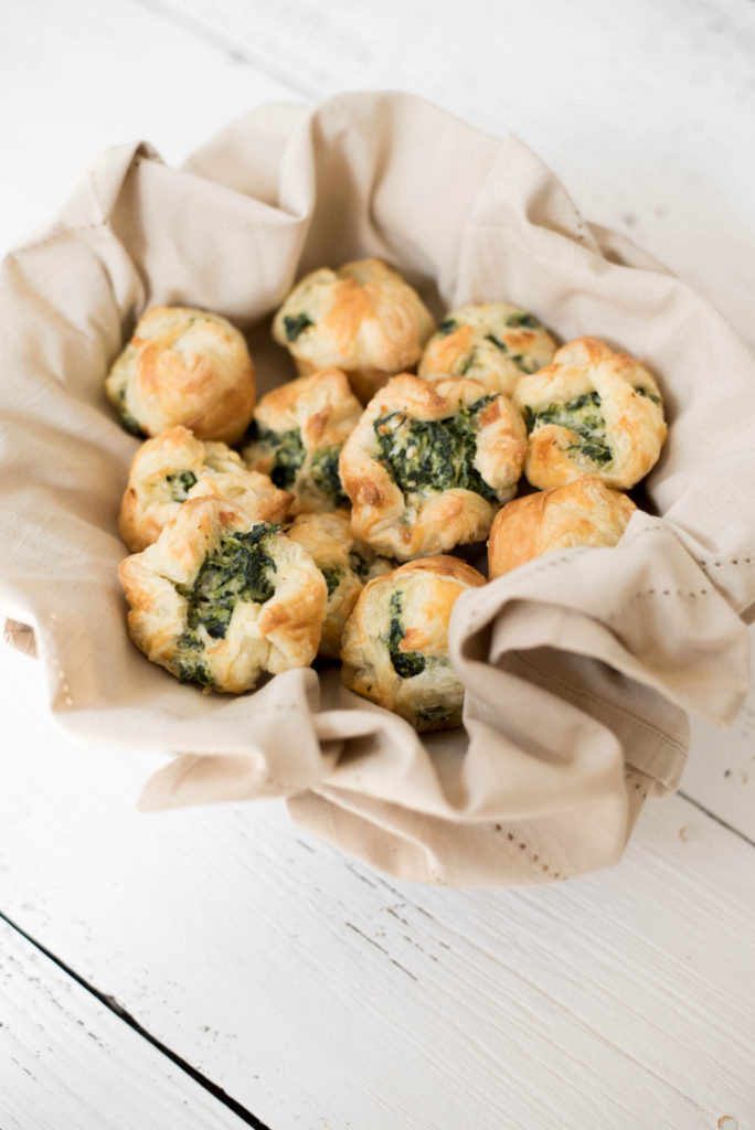 Flaky Puff pastry cups full of chopped spinach and cheese. Perfect for your next party!