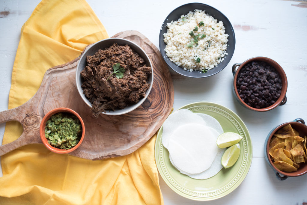 This slow cooker beef barbacoa recipe comes together in 5 minutes and cooks all day or till tender and falling apart. Dinner & leftovers will be delicious! from FirstandFull.com