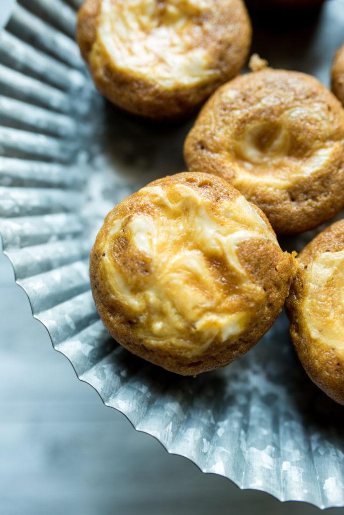 Pumpkin Cream Cheese Muffins: warm cinnamon and nutmeg, rich cream cheese swirled on top, + the ultimate taste of fall-- pumpkin! Similar to Starbucks Original.
