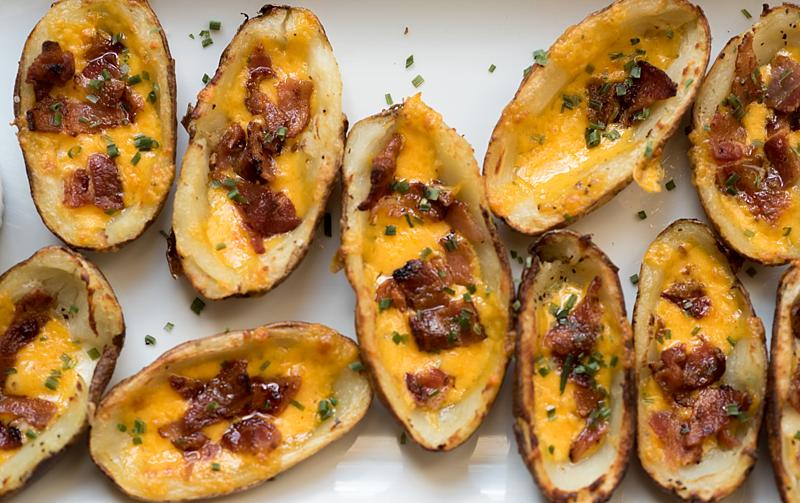 These crispy baked potato skins,topped with cheese and bacon, have all the makings of a sinful appetizer but are baked as opposed to fried. firstandfull.com