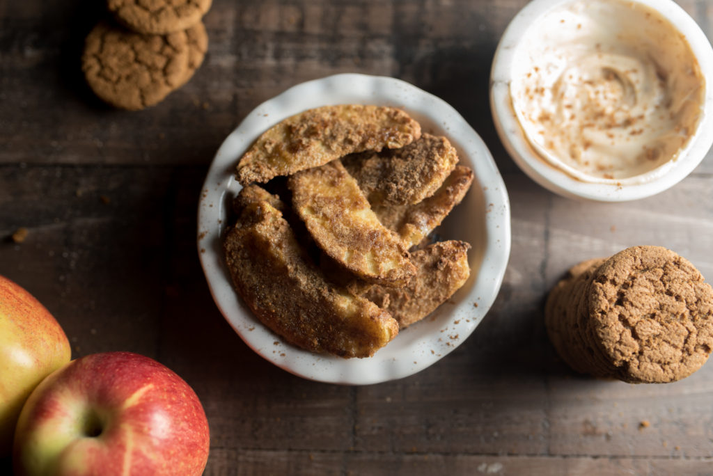 Cinnamon Apple Fries: A single apple sliced, coated with pulverized graham cracker crumbs and baked in the air fryer. They are delicious on their own, but SINFUL when dipped in creamy Greek yogurt sweetened with a drizzle of honey or maple syrup.