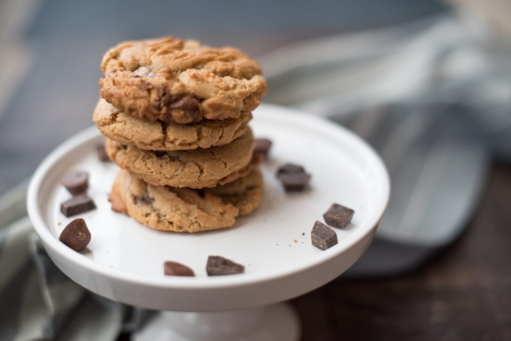 Peanut butter cookies turned up a notch! They are crisp on the outside, still gooey on the inside and stuffed with melty milk chocolate and crushed peanut butter cups. If you can believe it... they're even better when they cool down. | Firstandfull.com