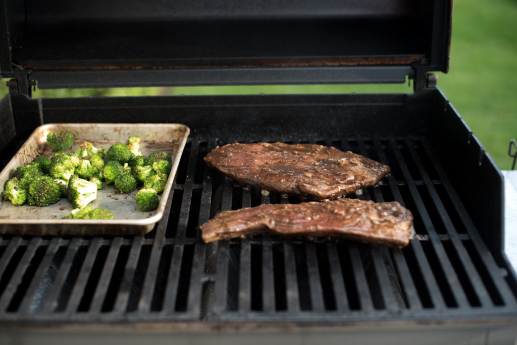 An easy flank steak marinade perfect for weeknight grilling. It's got soy sauce, ginger, garlic, and honey to create the most delicious and tender steak.   FirstandFull.com