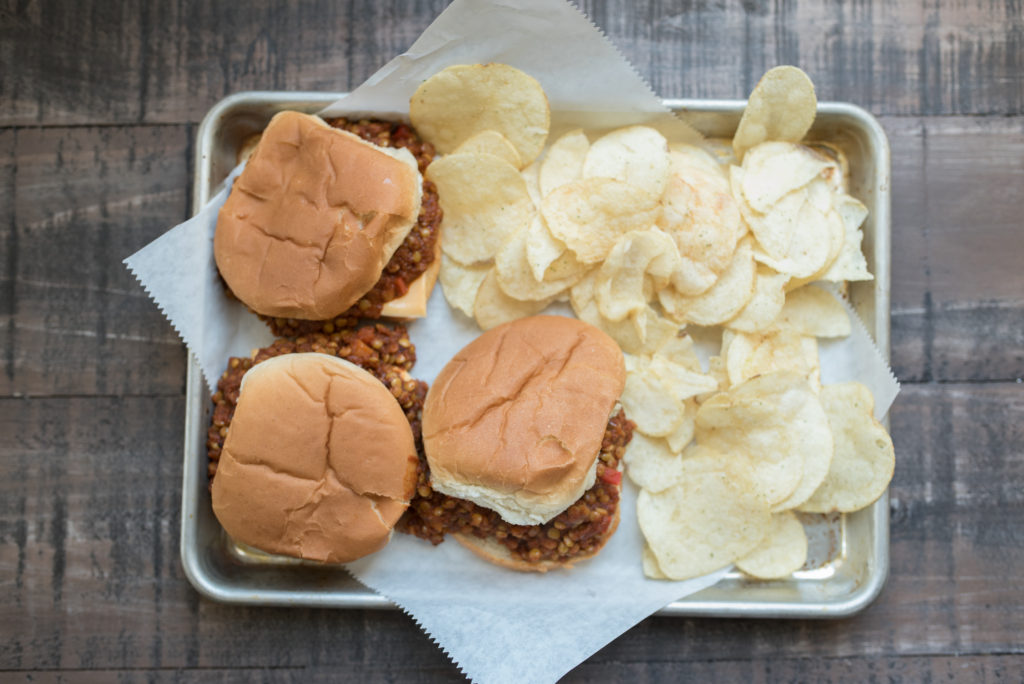 Vegetarian Lentil Sloppy Joes featuring a thick, hearty, and flavorful sauce piled high on hamburger buns! A modern take on the ones from your childhood.