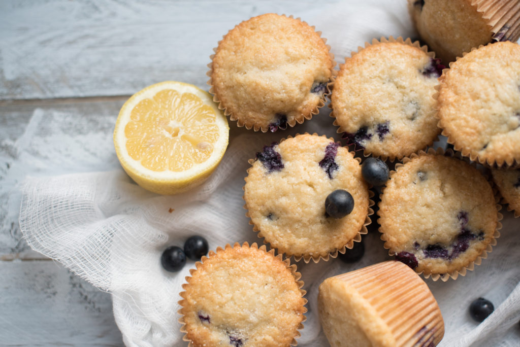 Blueberry Lemon Muffins bursting with fresh blue berries, a light lemon flavor tucked in the fluffiest muffin! The ULTIMATE breakfast/ brunch muffin!