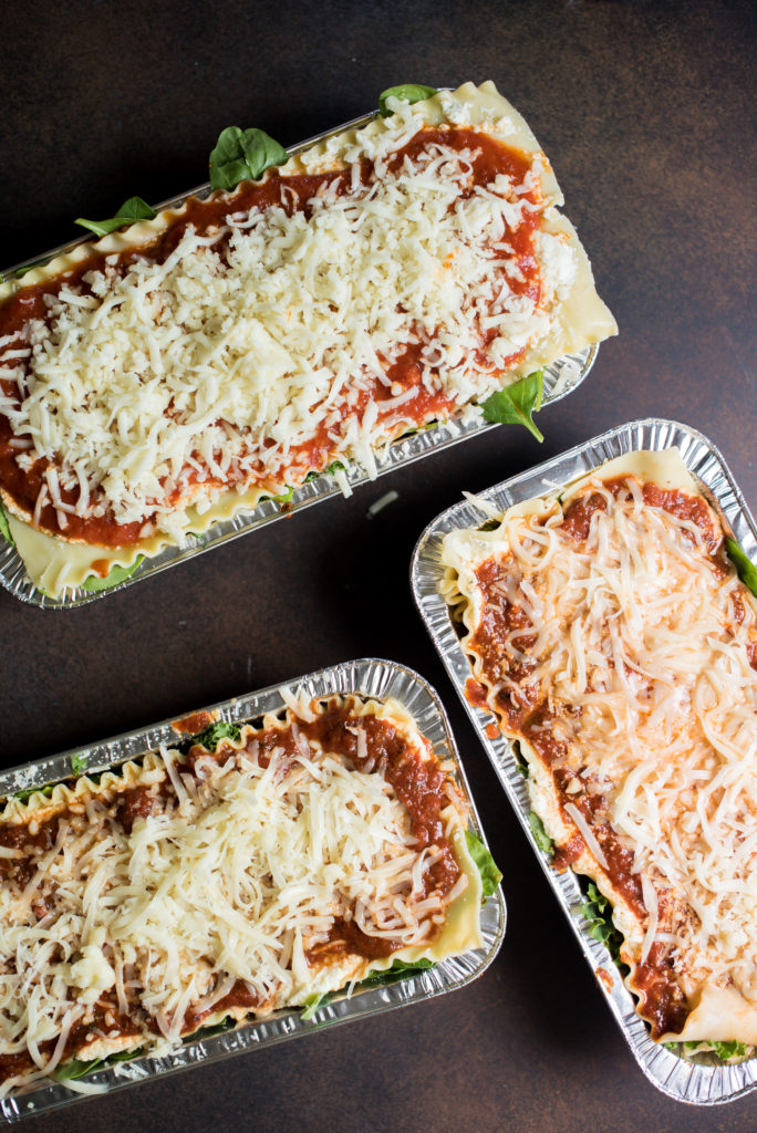 Vegetarian spinach lasagna recipe; layers stuffed with spinach and kale, a savory ricotta, and layered with mozzarella cheese. Make one for the freezer for an easy weeknight meal.