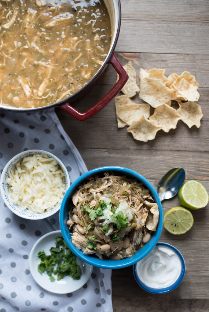White Chicken Chili: Light, Flavorful soup with white beans, tender shredded chicken, roasted peppers, topped w/ cilantro, cheese, avocado, and lime juice.
