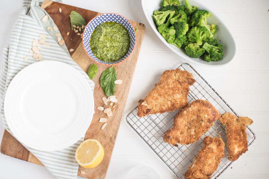 Almond Crusted Chicken Cutlets with Pesto: The nutty flavor from the almonds is slight, but when paired with the garlicky, citrusy pesto it just works! If your family is fond of chicken parmesan, they will adore this recipe for crispy almond crusted chicken and lemon- basil pesto.