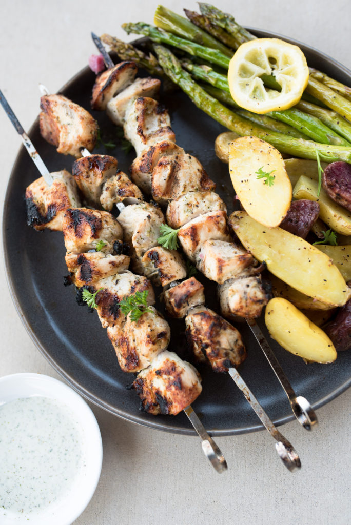 Ranch Grilled Chicken Skewers: Delicious grilled chicken skewers first marinated in a roasted garlic ranch sauce, grilled till juicy, and served with roasted potatoes, and grilled asparagus. A Whole30 Compliant recipe that all your guest will enjoy!