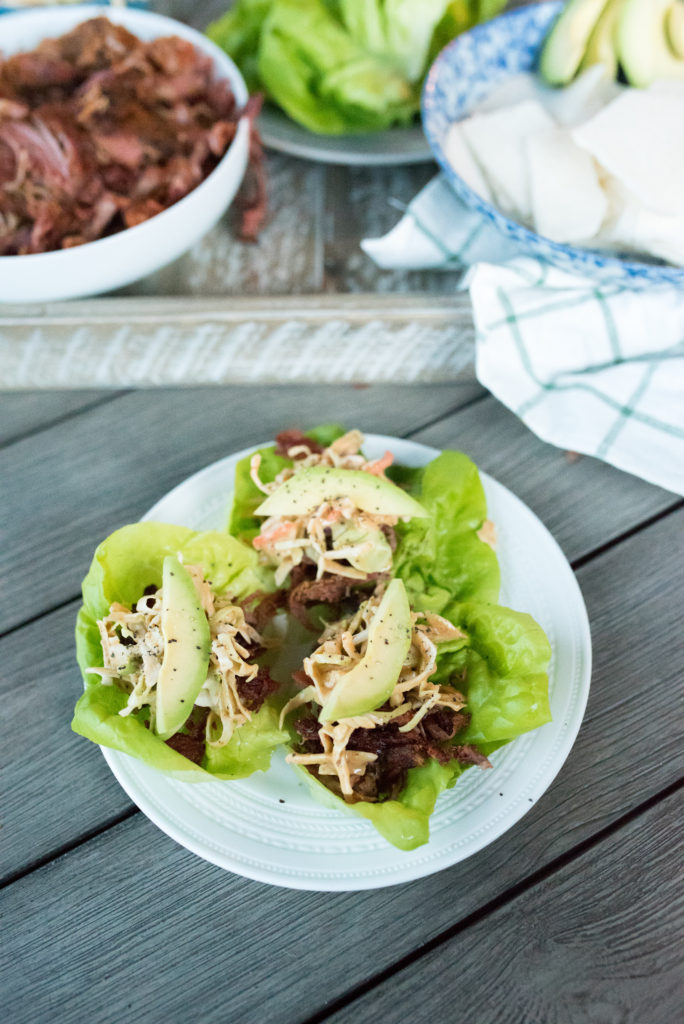 This Crispy Pulled Pork Dinner comes together in less than 10 minutes. Whole30 Compliant pulled pork, seasoned with southwestern spices, loaded in crisp lettuce cups topped with my signature creamy chipotle slaw make for a delicious meal. Clean eating made tasty and easy!