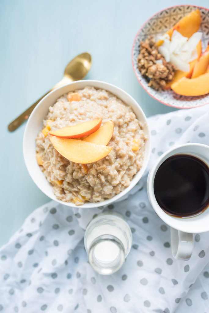 This Peaches and Cream Oatmeal is a decadent breakfast in a bowl. Sweet and creamy oatmeal with ripe peaches sautéed in brown sugar and a healthy drizzle of cream at the end.